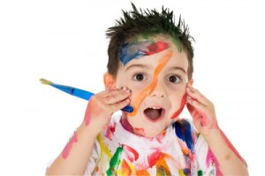 3 year old boy covered in paint.  Clipping path. Over white.